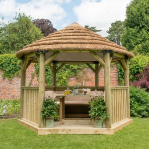Forest Garden 3.6m Hexagonal Wooden Garden Gazebo with Thatched Roof - Furnished with Table, Benches and Cushions (Cream)