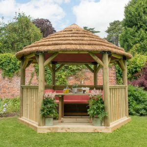 Forest Garden 3.6m Hexagonal Wooden Garden Gazebo with Thatched Roof - Furnished with Table, Benches and Cushions (Terracotta)
