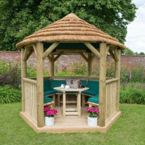 Forest Garden 3m Hexagonal Wooden Garden Gazebo with Thatched Roof - Furnished with Table, Benches and Cushions (Green)
