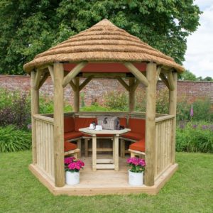 Forest Garden 3m Hexagonal Wooden Garden Gazebo with Thatched Roof - Furnished with Table, Benches and Cushions (Terracotta)