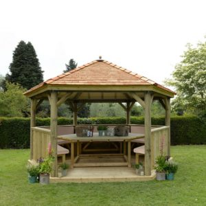Forest Garden 4.7m Hexagonal Wooden Garden Gazebo with Cedar Roof - Furnished with Table, Benches and Cushions (Cream)