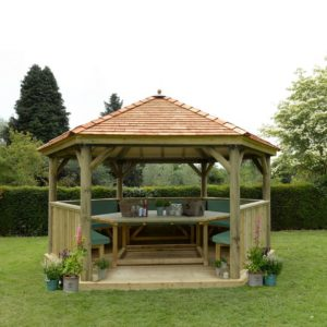 Forest Garden 4.7m Hexagonal Wooden Garden Gazebo with Cedar Roof - Furnished with Table, Benches and Cushions (Green)