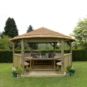 Forest Garden 4.7m Hexagonal Wooden Garden Gazebo with Thatched Roof - Furnished with Table, Benches and Cushions (Cream)