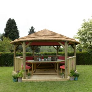 Forest Garden 4.7m Hexagonal Wooden Garden Gazebo with Thatched Roof - Furnished with Table, Benches and Cushions (Terracotta)