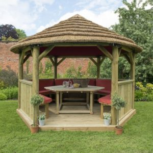 Forest Garden 4m Hexagonal Wooden Garden Gazebo with Thatched Roof - Furnished with Table, Benches and Cushions (Terracotta)
