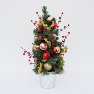 Merry yuletide christmas tree in zinc pot